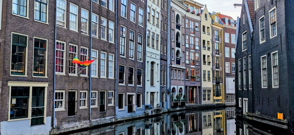amsterdam houses in the red light district over a canal