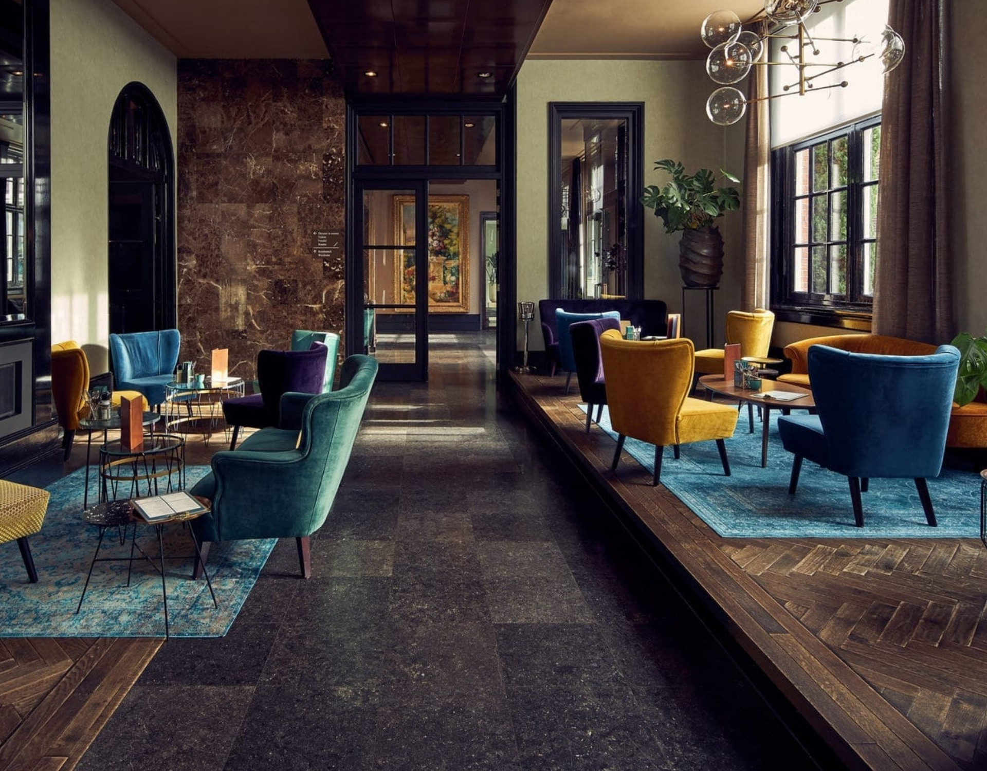 furniture and chairs in a hotel lobby in amsterdam