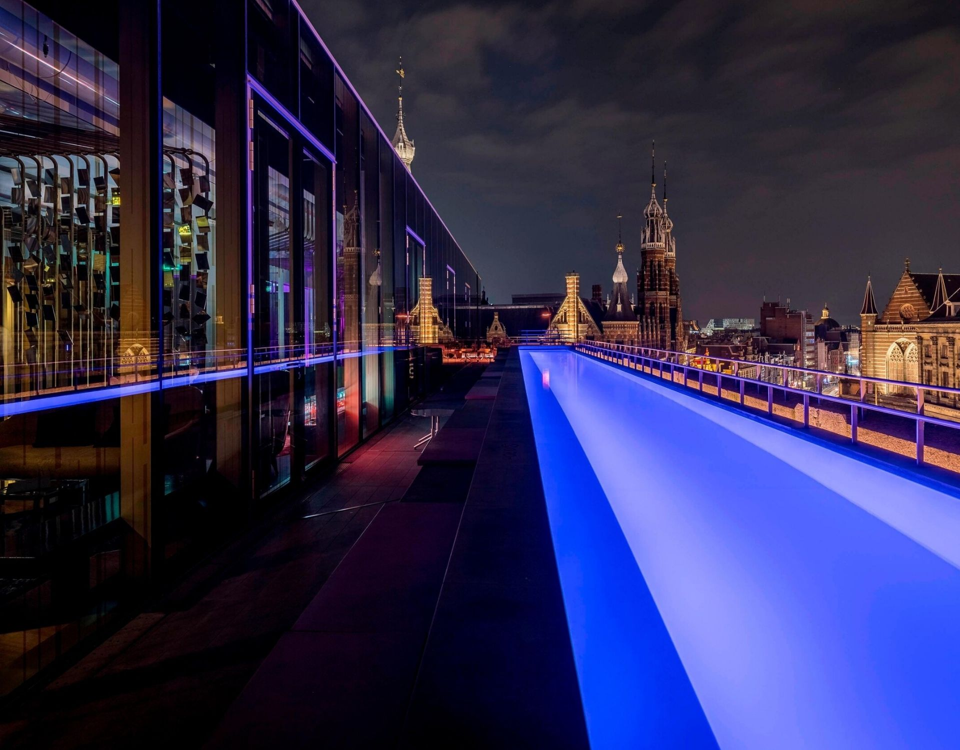 pool side and rooftop bar overlooking Dam Square Amsterdam at W Hotel Amsterdam